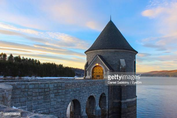 historic building in lake against blue sky - connecticut stock pictures, royalty-free photos & images