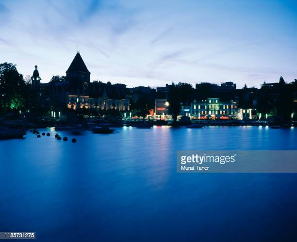 historic building on the waterfront at night in lausanne - image stock pictures, royalty-free photos & images