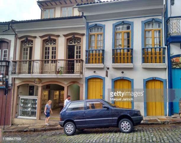 historic buildings and a parked car in ouro preto, minas gerais state - brazil - preto stock pictures, royalty-free photos & images