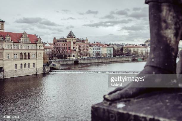 historic buildings in old town of prague. as seen from charles bridge on the banks of the vltava river - プラハ 旧市街広場 ストックフォトと画像