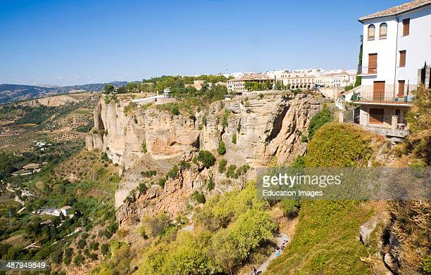 Historic buildings perched on sheer cliff top in Ronda Spain