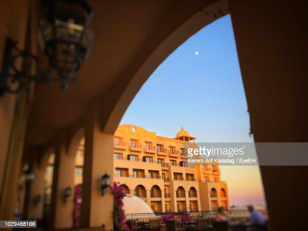 historic buildings seen through arch against sky - belek stock pictures, royalty-free photos & images