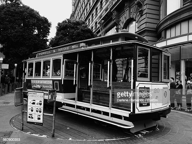 historic cable car against buildings on city street - cable car stock pictures, royalty-free photos & images