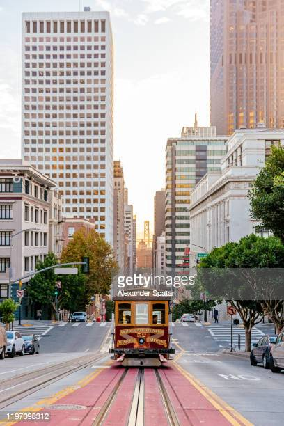 historic cable car on the street in san francisco, california, usa - san francisco california stock pictures, royalty-free photos & images