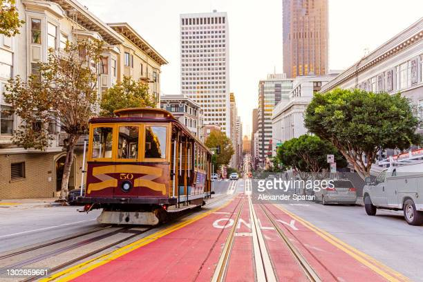 historic cable car on the street in san francisco, usa - san francisco california stock pictures, royalty-free photos & images