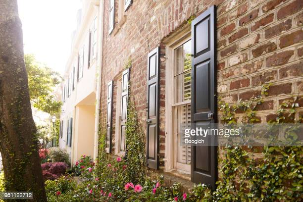 historic charleston windows in brick building exterior south carolina usa - shutter stock pictures, royalty-free photos & images