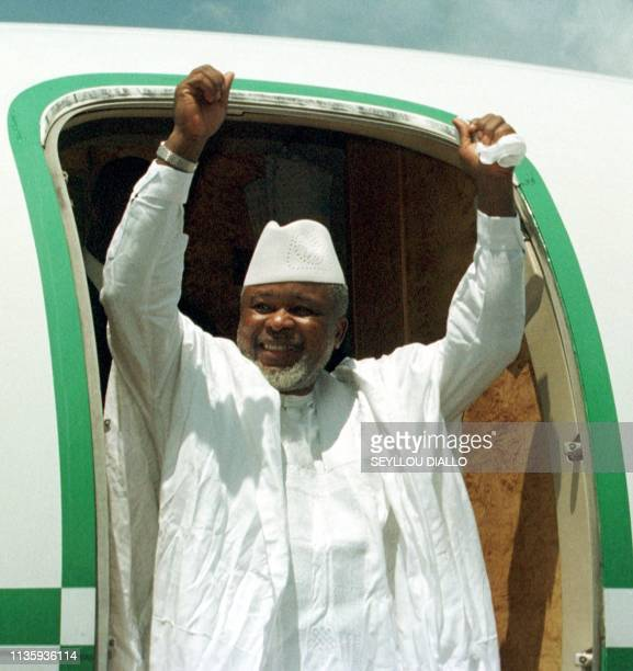 Historic chief of Sierra Leone's rebel United Revolutionnary Front Foday Sankoh comes out the plane 03 October 1999 in Lungi airport Freetown Sankoh...