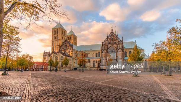 historic church in city against cloudy sky during sunset - north rhine westphalia stock pictures, royalty-free photos & images