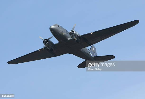 A historic DC3 airplane also known as the Rosinenbomber or Raisin Bomber flies near Tempelhof Airport September 2 2008 in Berlin Germany The...