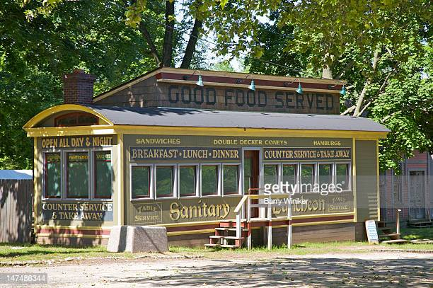 Historic diner under trees.