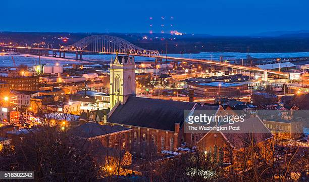 Historic downtown with the Cathedral of Saint Raphael in foreground and the Mississippi River in the background in Dubuque Iowa on January 30 2016...