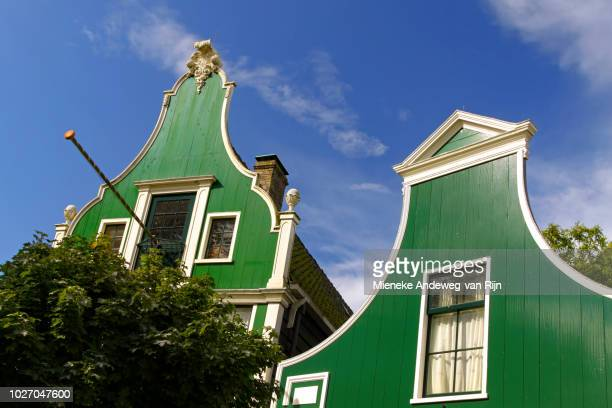 Historic gabled houses, made of wood and painted green at Zaanse Schans, Zaandijk, North Holland, The Netherlands.