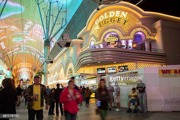 Historic Golden Nugget Hotel and Casino on Fremont Street in Las Vegas seen at night with visitors present