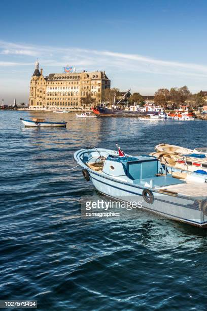 historic haydarpasa train station building with boats from bosphorus - haydarpasa stock photos and pictures
