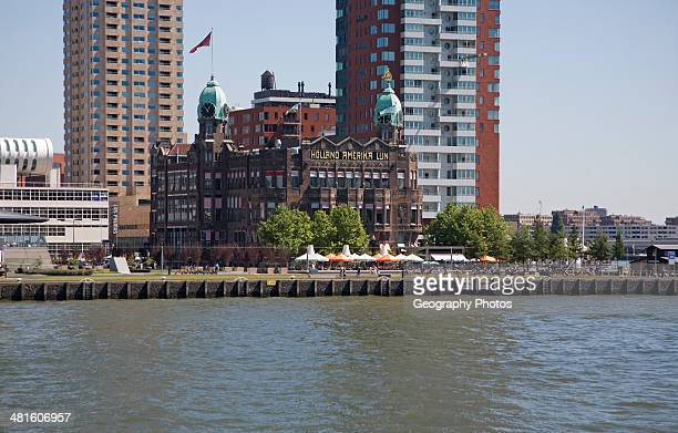 Historic Hotel New York building dwarfed by modern skyscrapers Rotterdam Netherlands