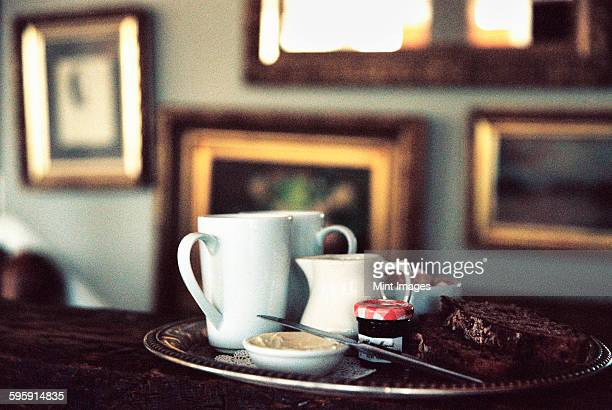 a historic late 18th century house interior, now a hotel and a restaurant. a tea tray on a table in a room full of pictures.  - 18th century style stock pictures, royalty-free photos & images