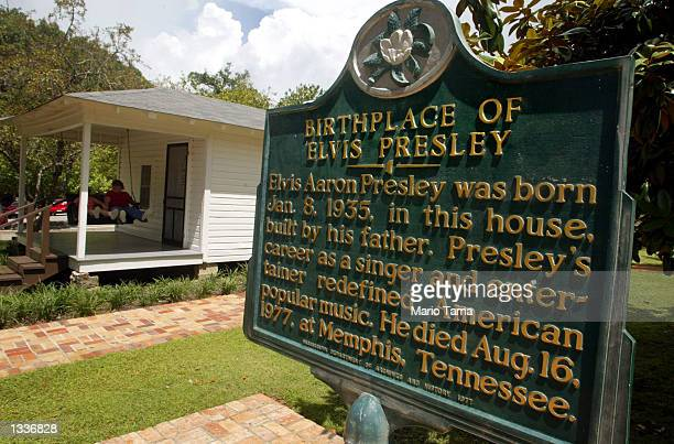 A historic marker is seen next to the tworoom house where Elvis Presley was born January 8 1935 during Elvis Week August 14 2002 in the singer's...