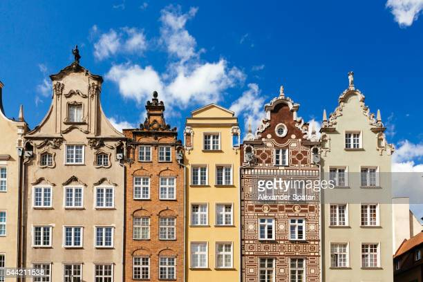 historic merchant houses standing in a row at the long market in gdansk, poland - polish culture stock photos and pictures