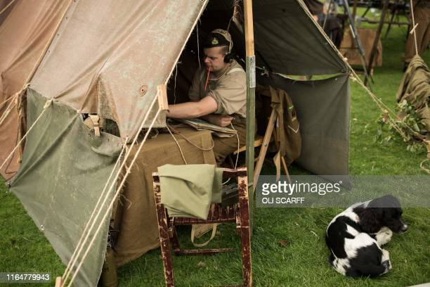 Historic military reenactor operates machinery in a tent on the first day of the Chatsworth Country Fair in the grounds of Chatsworth House, near...