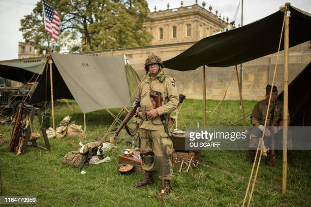 Historic military reenactor poses for a photograph in front of his tent on the first day of the Chatsworth Country Fair in the grounds of Chatsworth...
