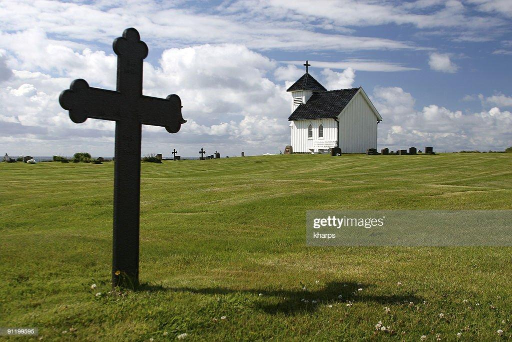 Historic Norwegian Church with cross gravestone : Stock Photo