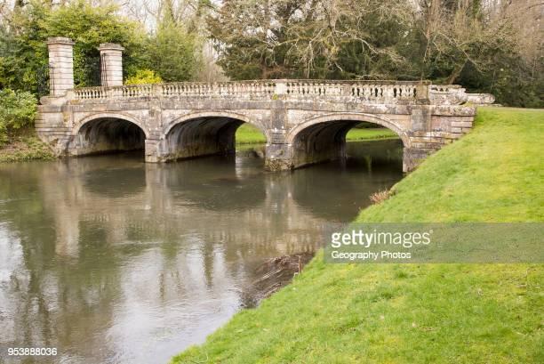Historic ornamental stone bridge over River Avon in Amesbury Abbey Park Amesbury Wiltshire England UK