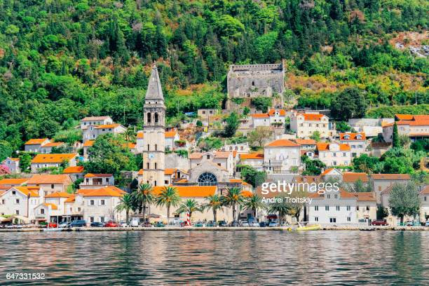 Historic Perast shoreline and bell tower viewed across Bay of Kotor from shuttle boat, Montenegro