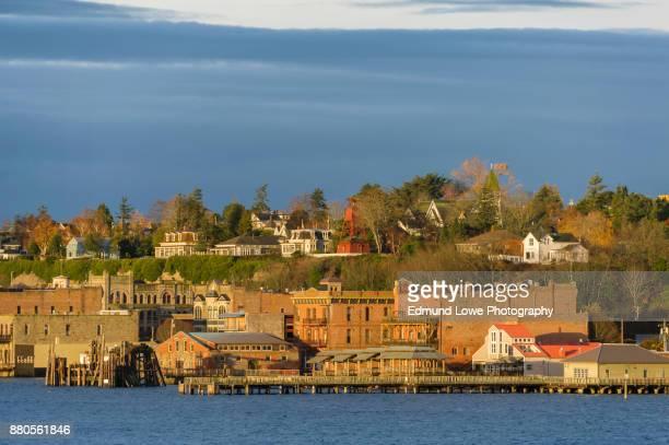 historic port townsend, washington waterfront at sunrise. - porträt bildbanksfoton och bilder