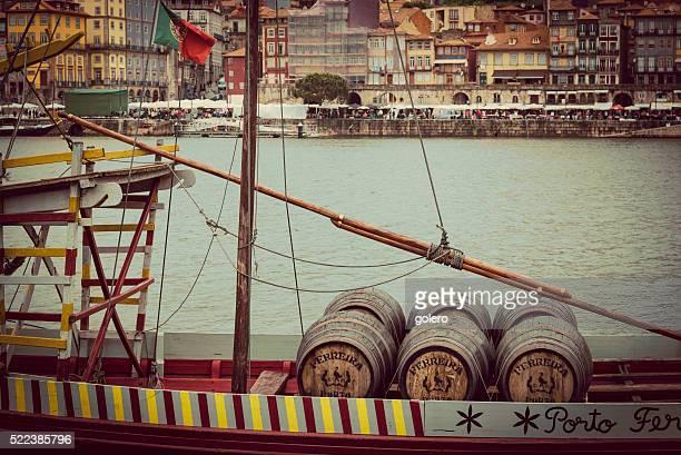 historic port wine boat on douro river in porto