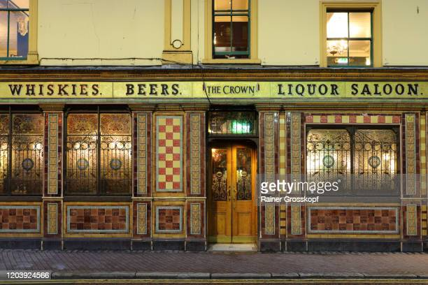 historic pub with colorful facade and windows at dusk - rainer grosskopf stock pictures, royalty-free photos & images