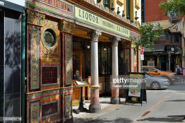 historic pub with colorful facade and windows in belfast - rainer grosskopf stock pictures, royalty-free photos & images