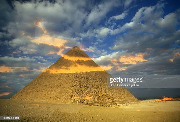 Historic Pyramid At Desert Against Cloudy Sky