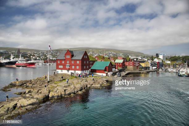 historic red houses of the parliament tinganes in tórshavn - torshavn stock pictures, royalty-free photos & images