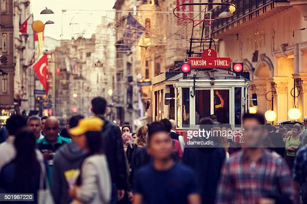 historic red tram on crowded istiklal avenue in taksim, istanbul - turkey middle east stock pictures, royalty-free photos & images