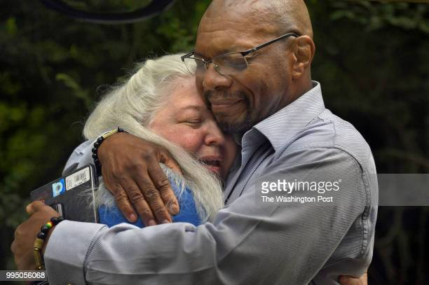 Historic researcher Jane Smith gets a hug of thanks from Don Gathers just after the ceremony that acknowledged a brutal lynching 120 years ago It was...