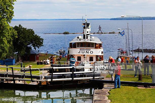 Historic river boat enters locks in Berg
