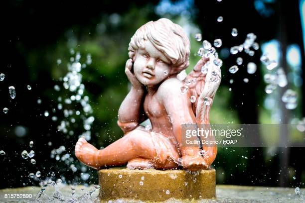 historic rock fountain - cherub stock pictures, royalty-free photos & images