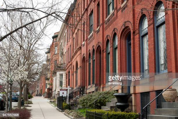 historic row houses on park avenue in midtown of baltimore - baltimore stock photos and pictures