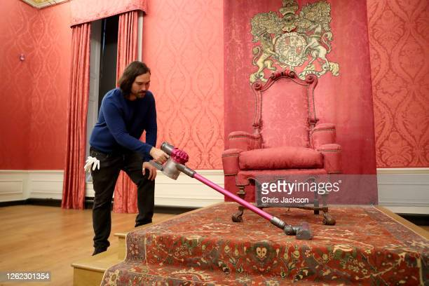 Historic Royal Palace conservator cleans the King's Presence Chamber ahead of the re-opening of Kensington Palace to the public tomorrow on July 29,...