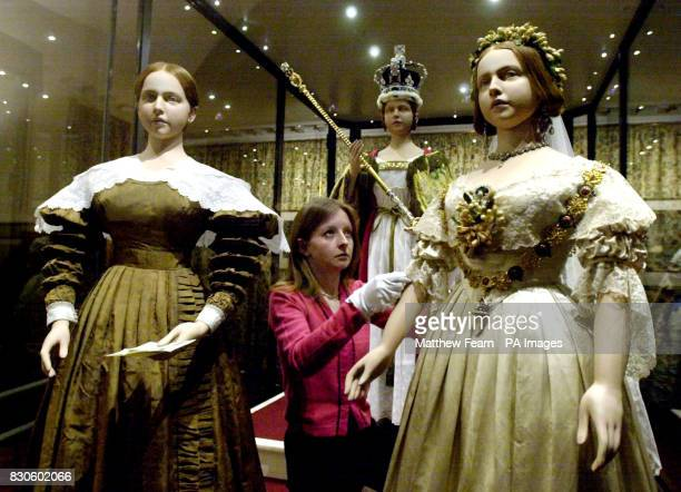Historic Royal Palaces Curatorial Assistant Jenny Lister adjusts the wedding dress worn by Queen Victoria at her marriage to Prince Albert in 1840 at...