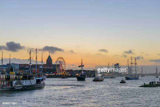 """historic sailing ships sailing up the river ijssel during the yacht parade at the 2014 sail kampen event - """"sjoerd van der wal"""" or """"sjo"""" stock pictures, royalty-free photos & images"""