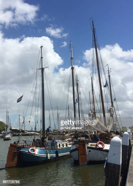 Historic sailing vessels belonging to the Dutch 'Brown Fleet' in the harbour in Enkhuizen Netherlands 28 July 2017 The ships are named after the...