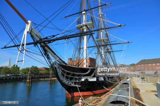 historic ship uss constitution at the pier of charlestoen navy yard in boston - rainer grosskopf stock pictures, royalty-free photos & images