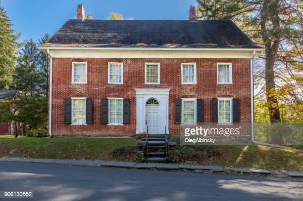 historic single family brick home and green trees in new paltz, hudson valley, new york. - brick house stock pictures, royalty-free photos & images