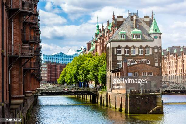 historic speicherstadt in hamburg with elbphilharmonie in the background, germany - hamburg germany stock pictures, royalty-free photos & images