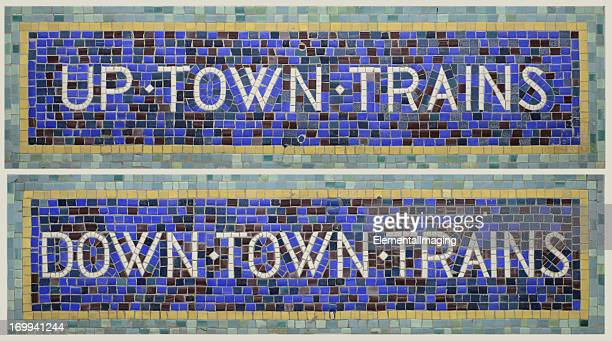 historic tile mosaic new york city subway signs uptown/downtown trains - new york city subway stock pictures, royalty-free photos & images
