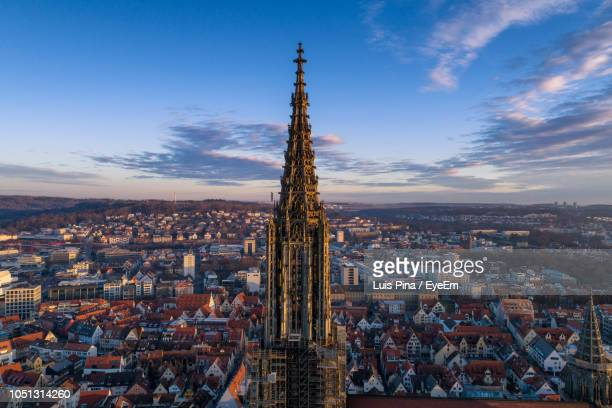 historic tower in city against sky during sunset - ulm stock pictures, royalty-free photos & images
