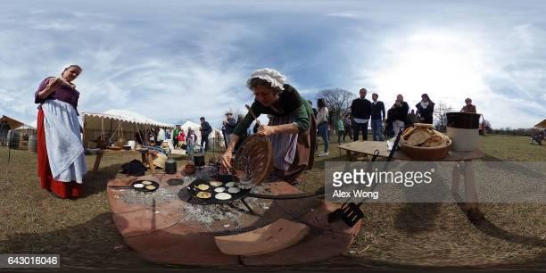 Historic trades interpreters Kathrin Breitt Brown and Deb Colburn demonstrate cooking hoecakes the favorite breakfast food of George Washington as...