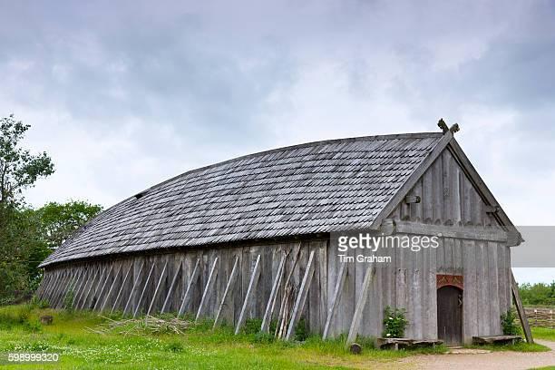 Historic viking longhouse reconstruction with oak shingles roof at Ribe Viking Center heritage centre in South Jutland Denmark