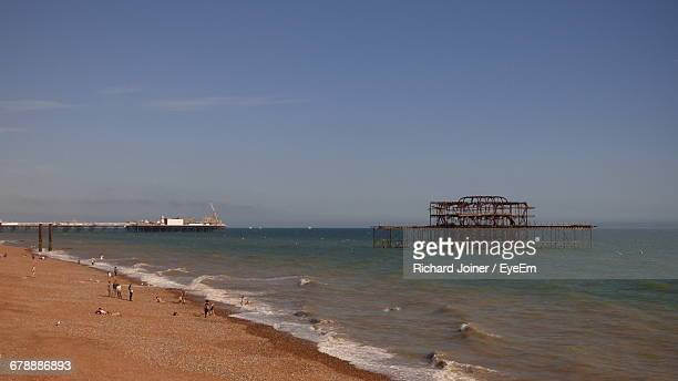 historic west pier in sea against sky - hove stock pictures, royalty-free photos & images